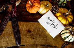 Happy Thanksgiving Day Card handwriting Thank you with copy space. Thank you card on beautiful autumn Thanksgiving day dinner table with traditional fall harvest Royalty Free Stock Photography