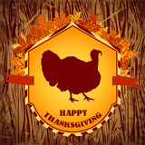Happy Thanksgiving day. Vintage hand drawn vector illustration with turkey and autumn leaves on wooden background. Royalty Free Stock Photo