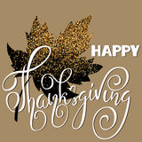 Happy Thanksgiving Day White hand lettering on golden background greeting card. Gold glitter leaf Stock Photography