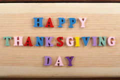 HAPPY THANKSGIVING DAY - word on wooden background composed from colorful abc alphabet block wooden letters, copy space royalty free stock photo