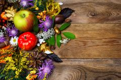 Happy Thanksgiving decor with golden acorn on wooden background Royalty Free Stock Photography