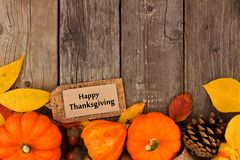 Happy Thanksgiving gift tag with autumn bottom border over wood Stock Image