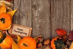 Happy Thanksgiving gift tag with autumn corner border over wood Stock Images