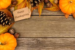 Happy Thanksgiving gift tag with autumn corner border over wood Royalty Free Stock Images