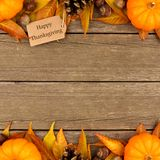 Happy Thanksgiving gift tag with autumn double border over wood Stock Photos