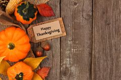 Happy Thanksgiving gift tag with autumn side border over wood Stock Image