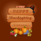 Happy Thanksgiving, graphic background with wooden sign and farmer hat Royalty Free Stock Image