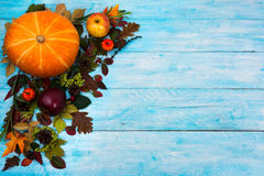 Happy Thanksgiving  greeting with fall leaves on blue wooden bac Royalty Free Stock Images