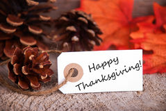 Happy Thanksgiving Greetings. White Label with Happy Thanksgiving and a Fall Background royalty free stock images