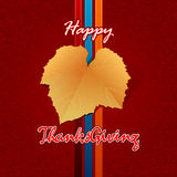Happy Thanksgiving, handwriting message with fabric texture backdrop and vine leave Stock Photos