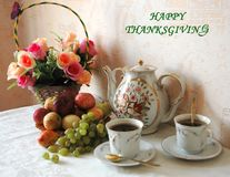 Happy thanksgiving. On the table there are flowers,tea, fruits Stock Images