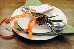 Happy Thanksgiving individual dinner table place setting with autumn flowers Stock Images