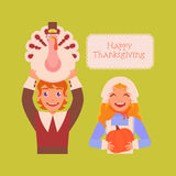 Happy thanksgiving. Joyful pilgrim boy and a girl carry products on holiday. Turkey in the hands of man and pumpkin in the hands of women. Masquerade in honor of Stock Images