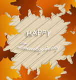 Happy Thanksgiving. Maple leafs frame on wooden background Royalty Free Stock Photo