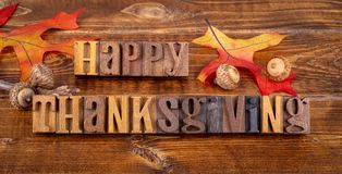 Happy Thanksgiving Message With Autumn Leaves and Acorns royalty free stock photo