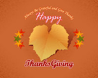 Happy Thanksgiving message with fabric texture backdrop and vine leave Royalty Free Stock Images