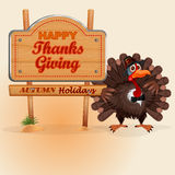 Happy Thanksgiving, message on wooden sign and cartoon turkey Royalty Free Stock Images