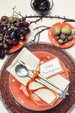 Happy Thanksgiving orange polka dots dinner table setting. Aerial. Happy Thanksgiving lunch, brunch or casual modern dining shabby chic table with autumn fall royalty free stock photo
