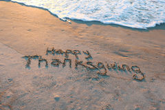 Happy Thanksgiving in sand Stock Photos