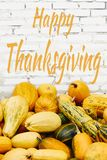 Happy Thanksgiving sign and pumpkins royalty free stock photos