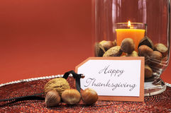 Happy Thanksgiving table setting centerpiece with ornage candle and nuts Stock Image
