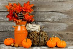 Happy Thanksgiving tag with autumn decor against wood. Happy Thanksgiving tag, pumpkins and autumn home decor with rustic wood background Stock Photo