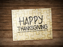 Happy thanksgiving text on the puzzle Stock Photography