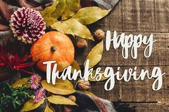Happy thanksgiving text sign on autumn pumpkin with leaves and w stock photo