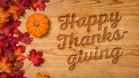 Happy Thanksgiving. A wooden background with autumn foliage - Happy Thanksgiving Royalty Free Stock Photo