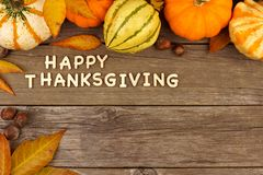 Happy Thanksgiving wooden letters with autumn corner border on wood Stock Photos
