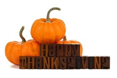 Happy Thanksgiving wooden letters with pumpkins over white Royalty Free Stock Photo