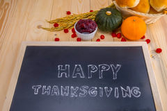 Happy Thanksgiving word cloud on a vintage slate blackboard. Stock Photos