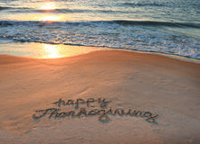Happy Thanksgiving. Written in the sand during a sunrise at the beach royalty free stock photography