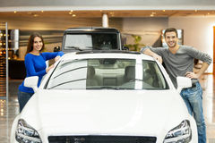 Happy with their new car. Royalty Free Stock Photography
