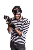 Happy thief holding stolen jewelry Royalty Free Stock Photos