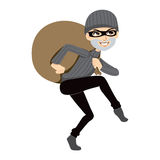 Happy Thief Sneaking. Carrying a huge bag of stolen property Royalty Free Stock Images