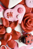 Happy things. Macro shot of various pink and happy decorations made from clay Stock Photo