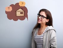 Happy thinking casual woman in eyeglasses looking up on illustra stock image