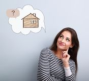 Happy thinking casual woman in looking up on illustration house royalty free stock images