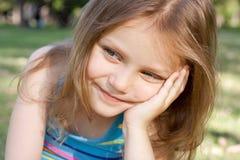 Happy thinking child. Portrait of a happy child thinking Royalty Free Stock Image