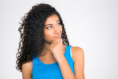 Happy thoughtful afro american woman looking up Royalty Free Stock Photo