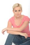 Happy Thoughtful Attractive Relaxed Young Woman Sitting on the Floor Royalty Free Stock Photography