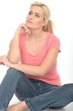 Happy Thoughtful Attractive Young Woman Sitting on the Floor Relaxing Royalty Free Stock Image