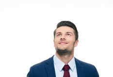 Happy thoughtful businessman looking up Royalty Free Stock Image
