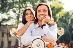 Happy thoughtful couple on scooter Royalty Free Stock Photography