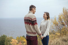 Happy thoughtful couple standing on a cliff near sea hugging eac Royalty Free Stock Photography