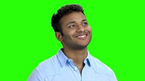 Happy thoughtful Indian guy on green screen. Thoughtful man standing daydreaming recalling happy memories. Chroma Key background stock video