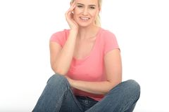 Happy Thoughtful Relaxed Young Woman Sitting on the Floor Smiling Stock Photos