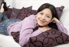 Happy thoughtful woman lying Royalty Free Stock Photo