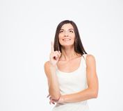 Happy thoughtful woman pointing finger up Royalty Free Stock Photo